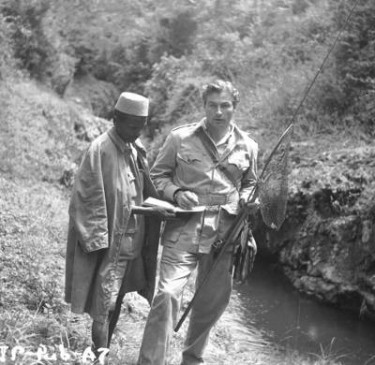 Lex Barker fishing in Africa whilst filming Tarzans Peril 1951