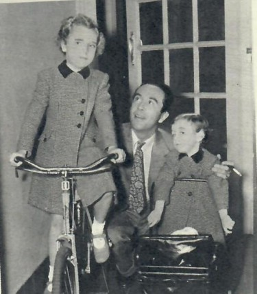 Dennis Price with his daughters