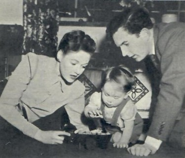 Rosamund John with her son and husband